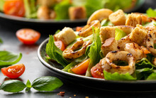 Grilled Squid Or Calamari And Shrimp Salad With Garlic Croutons And Cherry Tomatoes. Healthy Food.
