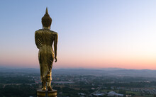 Big Golden Buddha Statue Standing In Wat Phra That Kao Noi On Morning At Nan, Thailand,