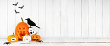 Halloween Display With Jack O Lanterns Against A Rustic White Wood Panel Background. Copy Space.