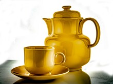 Golden Jug With A Cup
