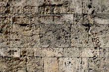 Damaged Granite Stone Surface From A Wall Of A Fortress With Big Bricks, Textured With Moisture - Dirty Pattern With For A Medieval Background
