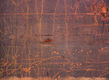 Rusty Metal Surface With Deep Orange Scratches Over A Dark Brown Background - Artistic Effect With Irregular Lines And Dots From The Wall Of A Mental Hospital