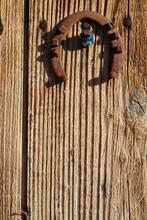Horseshoe And Evil Eye Bead On Old Wooden Door