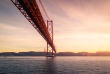 Mooring Poles Under Bridge At Sundown