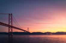 Modern Bridge Over River At Sunset