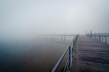 Wooden Pier In Foggy Morning