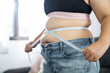 Chubby Obese Woman check Out Body Fat With Measuring Tape Health Care Diet Lifestyle Concept