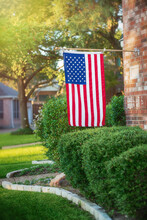American Flag Flying At Half-staff Of A Residential Home