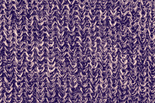 Purple Colour Monochrome Texture Knitted Fabric. Purple Knitted Jersey As Textile Background. Wool Knitting Texture.