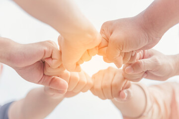 Close up hands Diverse multiethnic Partners team together. Teamwork group of multi racial people meeting join hands. Diversity people hands join empower partnership teams connect volunteer community