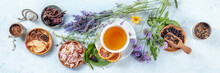 Organic Tea Panorama With Herbs, Flowers And Fruit, Shot From The Top. Healthy Hot Drink Panoramic Banner With Lavender And Rose