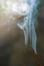 A Beautiful Pattern Of Backlit Smoke From Burning Incense And Incense Sticks Outdoors. The Concept Of Rituals, Religious Ceremonies In The Open Air. Meditation, Self-knowledge, Spirituality. Copyspace