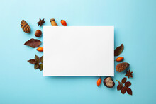 Autumn Composition. Paper Blank With Dried Flowers And Leaves On Blue Background. Autumn, Fall Concept. Flat Lay, Top View, Copy Space, Square