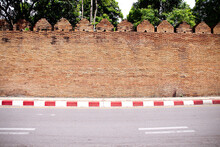 Antique Brick Wall Background ( Tha Pae Gate ) And Street In Chiang Mai Of  Thailand