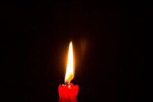 Red Paraffin Mournful Commemorative Thick Candle Burns On A Black Background