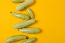 Fresh Vegetable Marrow Isolated On Yellow Background