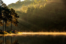 Beautiful Landscape Sunshine Rays Of Light In The Morning And Lake In Pine Forest Trees At Pang-Ung Camping Place, Mae Hong Son, Thailand.