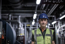 Portrait Of Male Engineer Working In An Industrial Plant Room