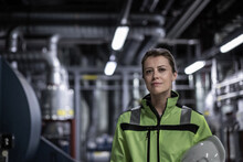 Portrait Of Female Engineer Working In An Industrial Plant Room