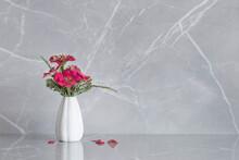 Pink Zinnia Flowers On Vase On Marble Background