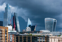 City Of London Busines District Shiny Skyscrapers Set Against A Dramatic Stormy Sky.