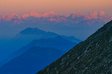 Pink Dolomites Mountains Illuminated By The First Rays Of Morning Sun.