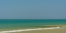 Beach On Thre French Opal Coast With Wooden Poles As Wave Breaker