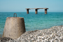 The Wild Coast Of The Black Sea. Breakwater On The Background Of The Blue Sea