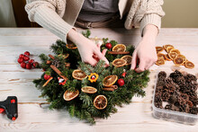 Woman Shows How To Make Traditional Christmas Door Wreath With Fir, Tutorial.