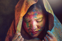 Portrait Of An Indian Woman Covered In Multi Coloured Powder During Holi Festival