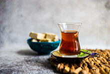 Cup Of Traditional Turkish Sweet Tea With A Bowl Of Pistachio Halva