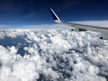 Aircraft Wing In Flight Over Clouds
