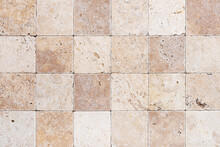 Natur Stone Wall From Small Square Parts. Background Or Texture For Interior.