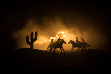 Western Cowboy Silhouette With Texture At Sunset And Slivers Of Light