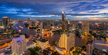 The Scenic View Curved Of The Chao Phraya River In Bangkok City Downtown At Sunset, Capital Of Thailand