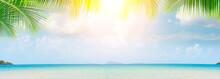 Panorama Of Blurred Blue Sky And Sea With Bokeh Light With Copy Space Between Palm Trees, The Landscape Of Tropical Summer, Summer Vacation Concept.