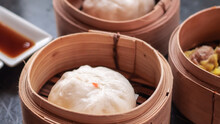 Chinese BBQ Pork Buns Served .Dim Sum, Traditional Chinese Dumplings, In Bamboo Steamer Basket. Asian Food