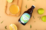 Bottle and glass of tasty kombucha tea on color background