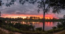 Beautiful Panoramic Riverside Sunset With Cloud Reflections