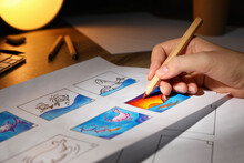 Woman Drawing Cartoon Sketch In Storyboard At Workplace, Closeup. Pre-production Process