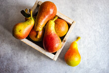 Fresh Organic Pears In A Wooden Box On A Table