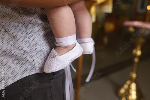 Fotografie, Obraz father holds a small child being baptized in a church