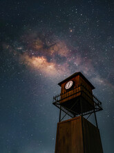 Wooden Tower With A Clock On A Starry Night
