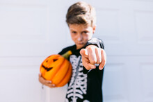 Kid In Halloween Costume Pointing At Camera