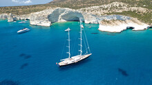 Aerial Drone Photo Of Sail Boat Anchored In Kleftiko - Iconic Beautiful Scenic White Volcanic Rock Formation Bay With Turquoise Crystal Clear Sea And Caves, Sea Meteora Of Greece, Milos Island