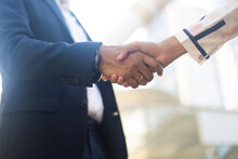 Businessman Shaking Hands On A Business Cooperation Agreement. Successful Business Woman Handshaking After Good Deal