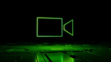 Green Video Camera Technology Concept With Recording Symbol As A Neon Light. Vibrant Colored Icon, On A Black Background With High Tech Floor. 3D Render