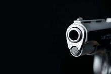 The Muzzle Part Of The Pistol Scene On A Black Background Represents A Concept Related To The Concept Of Abstract Weapons.