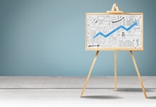 Wooden Easel With Growth Infographics Chart Diagram. Concept Of Success, Statistics And Business Analytics.