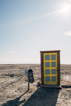 Door And Mail Box In Desert